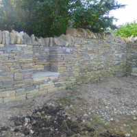 Dry stone walling seat feature